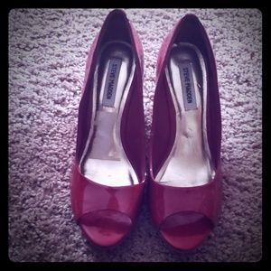 Steve Madden red patent leather peep toe wedges.